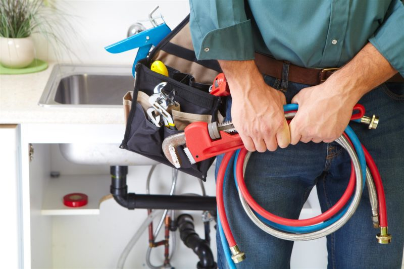 Plumber with plumbing tools and accessories